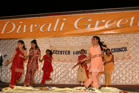 Children on-stage performing a traditional Indian dance during the Diwali Celebrations