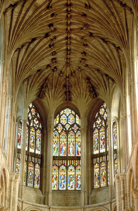 Bosses and stained glass windows in the vault of Norwich Cathedral