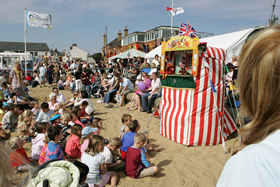 Punch and Judy show on the beach during the Old Leigh Regatta
