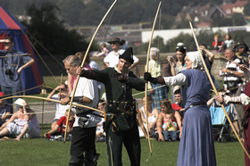 Archers firing arrows during Medieval Day at Rochester Castle.