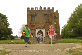 A family enjoying a day at Rye House Gatehouse in Lee Valley Park.