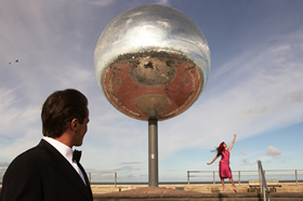 Couple dancing next to the world's largest mirrorball