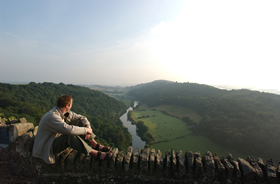Man admiring the view across the Wye Valley and Forest of Dean